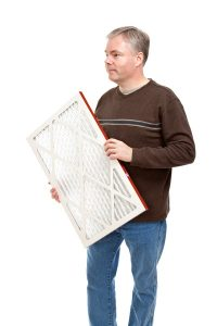 man-holding-air-filter