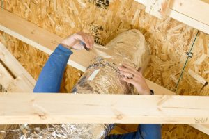 worker-sealing-ductwork-in-attic