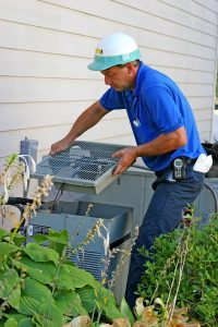 technician-servicing-outdoor-ac-unit